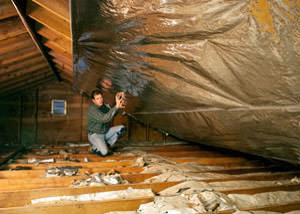A radiant barrier installed in a Lorain attic